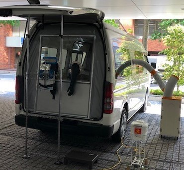 Photo of Toyoda Gosei,the PCR inspection of the vehicle to the Tokyo Medical Association offered to move the partition wall is also provided